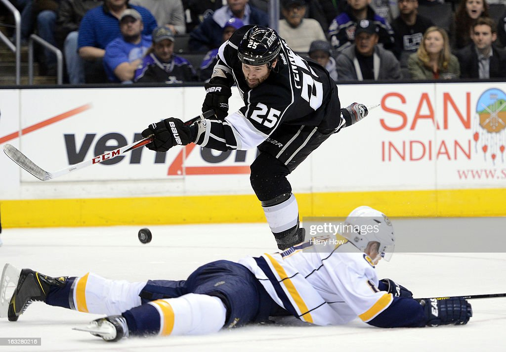 <a gi-track='captionPersonalityLinkClicked' href=/galleries/search?phrase=Dustin+Penner&family=editorial&specificpeople=589919 ng-click='$event.stopPropagation()'>Dustin Penner</a> #25 of the Los Angeles Kings shoots over a sliding <a gi-track='captionPersonalityLinkClicked' href=/galleries/search?phrase=Shea+Weber&family=editorial&specificpeople=554412 ng-click='$event.stopPropagation()'>Shea Weber</a> #6 of the Nashville Predators at Staples Center on March 4, 2013 in Los Angeles, California.