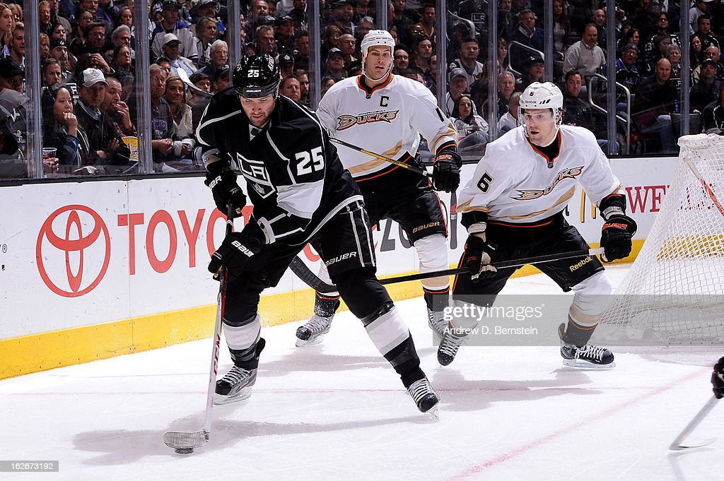 <a gi-track='captionPersonalityLinkClicked' href=/galleries/search?phrase=Dustin+Penner&family=editorial&specificpeople=589919 ng-click='$event.stopPropagation()'>Dustin Penner</a> #25 of the Los Angeles Kings skates with the puck against <a gi-track='captionPersonalityLinkClicked' href=/galleries/search?phrase=Ben+Lovejoy&family=editorial&specificpeople=4509565 ng-click='$event.stopPropagation()'>Ben Lovejoy</a> #6 of the Anaheim Ducks at Staples Center on February 25, 2013 in Los Angeles, California.