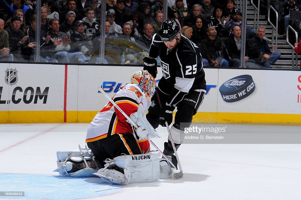 Dustin Penner #25 of the Los Angeles Kings tries to score against Joey MacDonald #35 of the Calgary Flames at Staples Center on March 11, 2013 in Los Angeles, California.