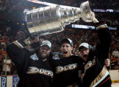 Dustin Penner Ryan Getzlaf and Corey Perry of the Anaheim Ducks celebrate lifting the Stanley Cup after defeating the Ottawa Senators in Game Five of...
