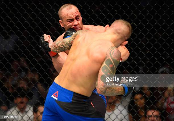 Dustin Poirier punches Eddie Alvarez in their lightweight fight during the UFC 211 event at the American Airlines Center on May 13 2017 in Dallas...