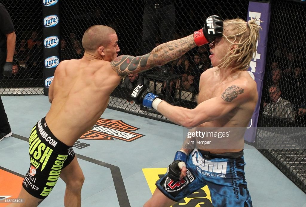 Dustin Poirier punches <a gi-track='captionPersonalityLinkClicked' href=/galleries/search?phrase=Jonathan+Brookins&family=editorial&specificpeople=7371194 ng-click='$event.stopPropagation()'>Jonathan Brookins</a> during their featherweight fight at the TUF 16 Finale on December 15, 2012 at the Joint at the Hard Rock in Las Vegas, Nevada.