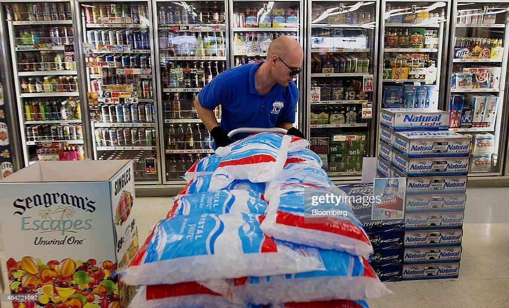 Dustin Stargel, delivery driver for Capital City Ice, wheels a cart of bagged ice through a Shop 'n Save grocery store in Columbus, Ohio, U.S., on Tuesday, Aug, 26, 2014. The Institute for Supply Management (ISM) is scheduled to release U.S. manufacturing figures on Sept. 2. Photographer: Ty Wright/Bloomberg via Getty Images