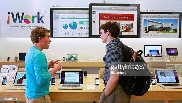 Dustin Swede right looks at a new MacBook Pro with Mac specialist Brabdt Dillestie at the Apple store in Salt Lake City Utah US on Wednesday April 22...