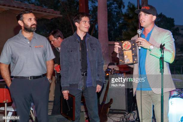 Dustin Tillman Richard Solis and Zeeshawn Zia onstage at the Swing Fore The Vets Charity Golf Tournament on October 19 2017 in Rancho Santa Margarita...