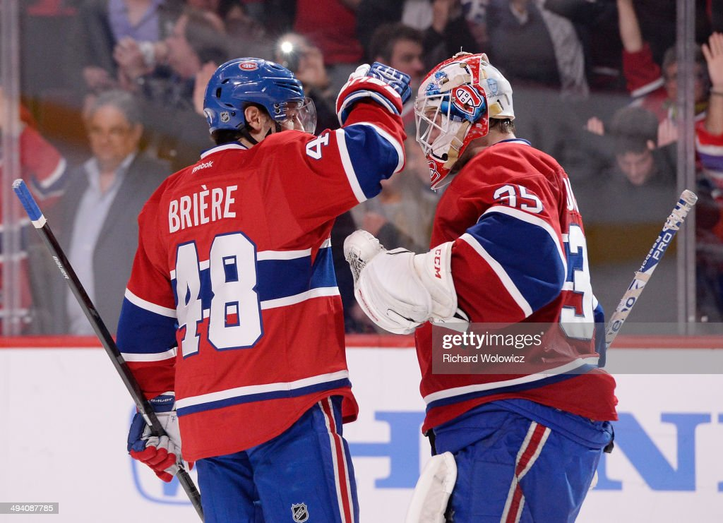 <a gi-track='captionPersonalityLinkClicked' href=/galleries/search?phrase=Dustin+Tokarski&family=editorial&specificpeople=4594196 ng-click='$event.stopPropagation()'>Dustin Tokarski</a> #35 and <a gi-track='captionPersonalityLinkClicked' href=/galleries/search?phrase=Daniel+Briere&family=editorial&specificpeople=201624 ng-click='$event.stopPropagation()'>Daniel Briere</a> #48 of the Montreal Canadiens celebrates after defeating the New York Rangers during Game Five of the Eastern Conference Final in the 2014 NHL Stanley Cup Playoffs at Bell Centre on May 27, 2014 in Montreal, Canada. Canadiens defeated the Rangers 7-4.