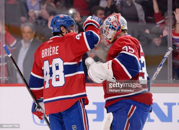 Dustin Tokarski and Daniel Briere of the Montreal Canadiens celebrates after defeating the New York Rangers during Game Five of the Eastern...