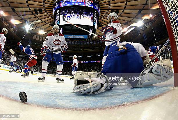 Dustin Tokarski of the Montreal Canadiens looks on after giving up a second period goal to Dominic Moore of the New York Rangers at 1807 during Game...