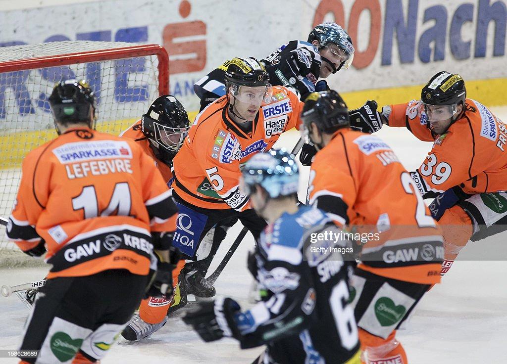 Dustin VanBallegooie of Graz (C) in action during the Erste Bank Eishockey Liga match between Black Wings Linz and Moser Medical Graz99ers at Keine Sorgen EisArena on December 21, 2012 in Linz, Austria.