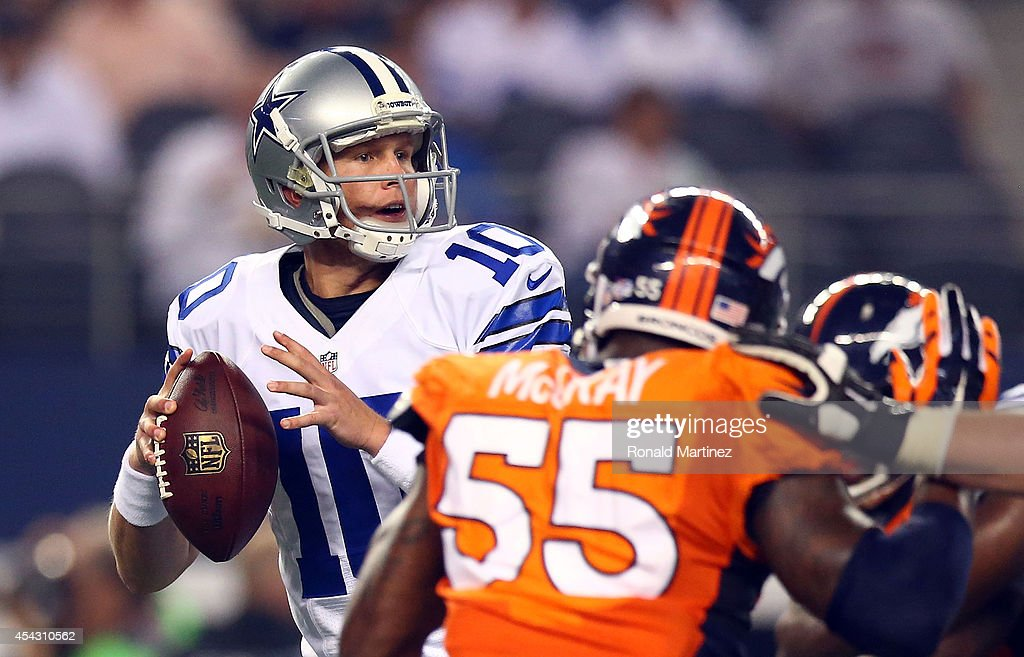 <a gi-track='captionPersonalityLinkClicked' href=/galleries/search?phrase=Dustin+Vaughan&family=editorial&specificpeople=12511790 ng-click='$event.stopPropagation()'>Dustin Vaughan</a> #10 of the Dallas Cowboys passes as <a gi-track='captionPersonalityLinkClicked' href=/galleries/search?phrase=Lerentee+McCray&family=editorial&specificpeople=7418300 ng-click='$event.stopPropagation()'>Lerentee McCray</a> #55 of the Denver Broncos rushes in the first half of their preseason game at AT&T Stadium on August 28, 2014 in Arlington, Texas.