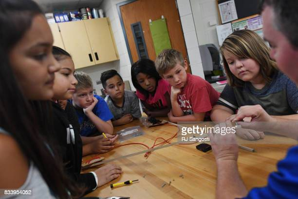 Dustin Vick's 5th grade stem class at Meadow Point Elementary works on building a weather balloon that they will launch during the eclipse on August...