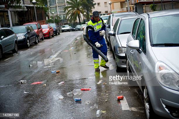 A dustman uses a blower for clearing empty beer cans plastic glasses and rubbish left by students after the second night of parties during the...