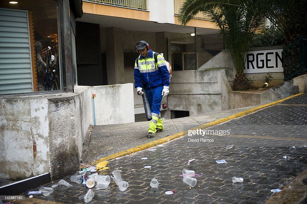 A dustman uses a blower for clearing empty beer cans, plastic glasses and rubbish left by students after the second night of parties during the SalouFest on April 3, 2012 in Salou, Spain. Saloufest is a university sports tour attended by thousands of British students taking part in a variety of competitions and parties over the Easter period in the Catalan village of Salou.