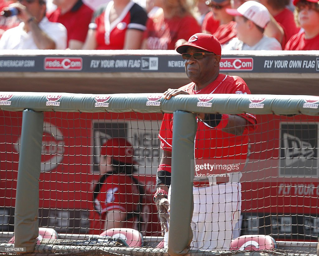 Dusty Baker #12 manager of the Cincinnati Reds calls a sign from the dugout during their game against the Pittsburgh Pirates at Great American Ball Park on September 28, 2013 in Cincinnati, Ohio.