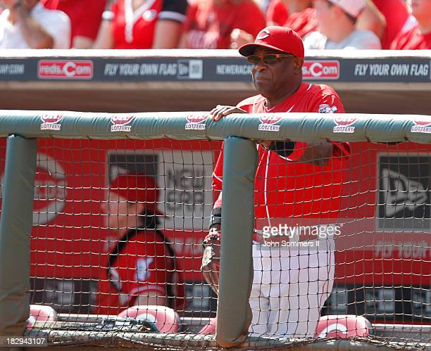 Dusty Baker manager of the Cincinnati Reds calls a sign from the dugout during their game against the Pittsburgh Pirates at Great American Ball Park...