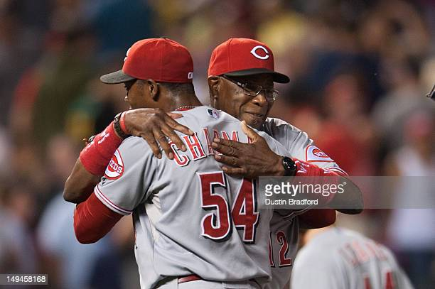 Dusty Baker of the Cincinnati Reds hugs his closer Aroldis Chapman after winning a game against the Colorado Rockies at Coors Field on July 28 2012...