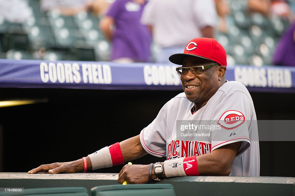 <a gi-track='captionPersonalityLinkClicked' href=/galleries/search?phrase=Dusty+Baker&family=editorial&specificpeople=202908 ng-click='$event.stopPropagation()'>Dusty Baker</a> #12 of the Cincinnati Reds smiles as he visits with fans in attendance before a game between the Colorado Rockies and the Cincinnati Reds at Coors Field on August 31, 2013 in Denver, Colorado. The Reds beat the Rockies 8-3.