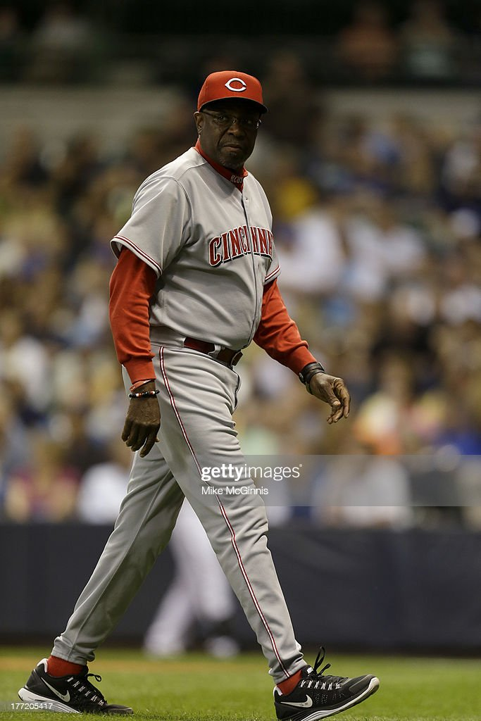 Dusty Baker #12 of the Cincinnati Reds walks to the dugout during the game against the Milwaukee Brewers at Miller Park on August 15, 2013 in Milwaukee, Wisconsin.