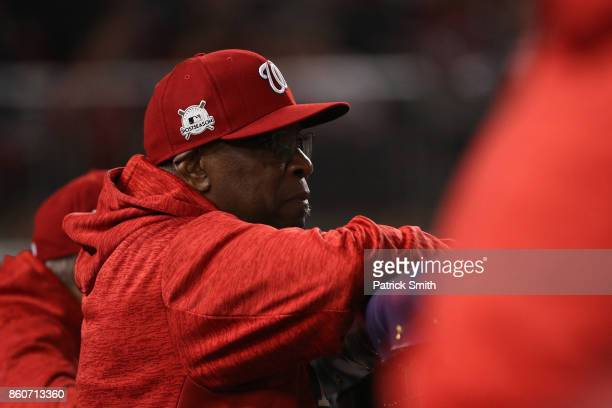 Dusty Baker of the Washington Nationals looks on against the Chicago Cubs during the third inning in game five of the National League Division Series...