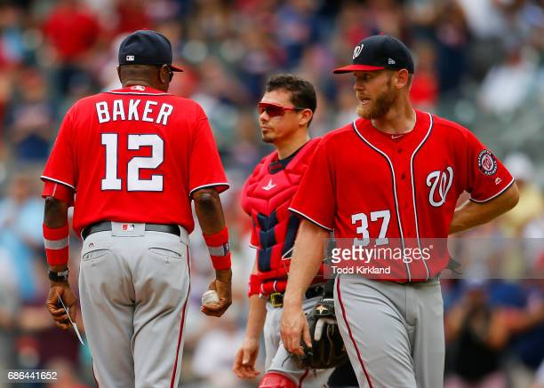 Dusty Baker of the Washington Nationals pulls Stephen Strasburg from the game after giving up a 2 run double in an MLB game against the Atlanta...