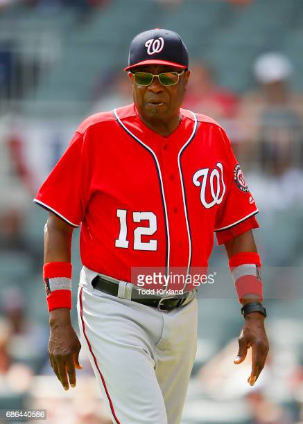Dusty Baker of the Washington Nationals returns to the dugout in the eight inning of an MLB game against the Atlanta Braves at SunTrust Park on May...