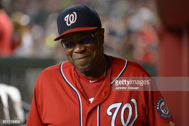 Dusty Baker of the Washington Nationals smiles while walking through the dugout in the MLB game against the Arizona Diamondbacks at Chase Field on...