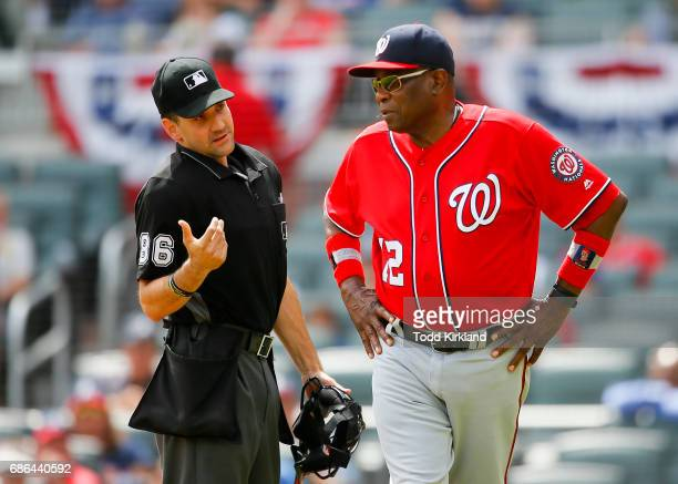Dusty Baker of the Washington Nationals speaks with umpire David Rackley concerning Bryce Harper being called out in an MLB game against the Atlanta...