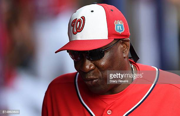 Dusty Baker of the Washington Nationals walks through the dugout during a spring training game against the New York Mets at Space Coast Stadium on...