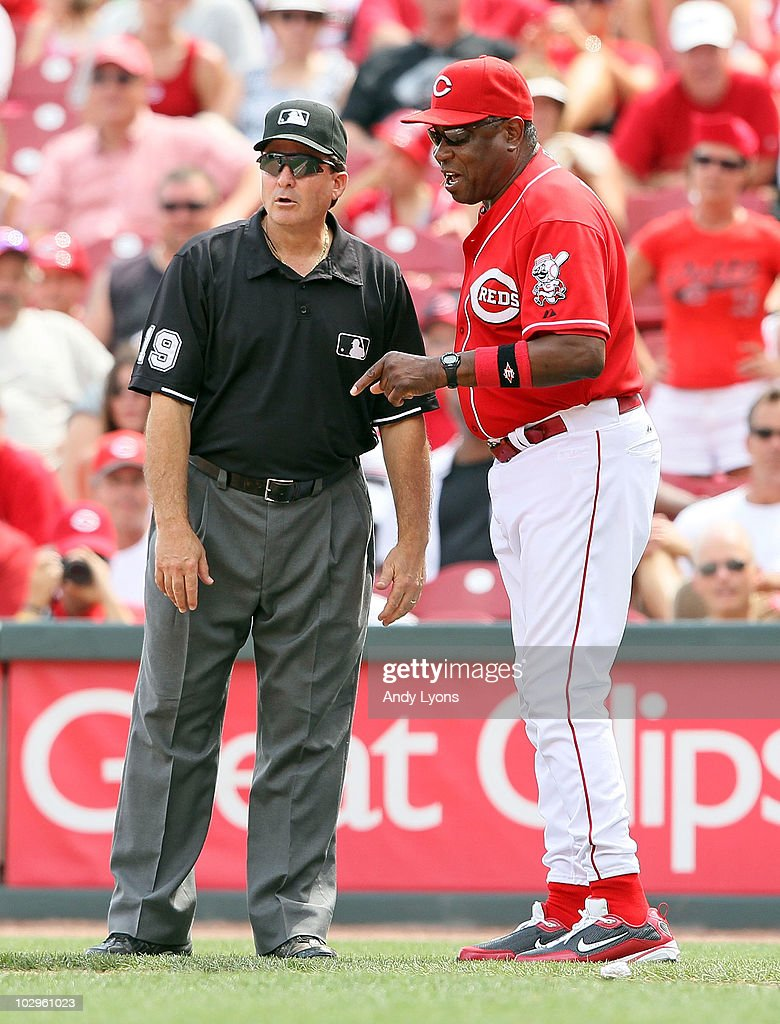 <a gi-track='captionPersonalityLinkClicked' href=/galleries/search?phrase=Dusty+Baker&family=editorial&specificpeople=202908 ng-click='$event.stopPropagation()'>Dusty Baker</a> the manager of the Cincinnati Reds talks with first base umpire <a gi-track='captionPersonalityLinkClicked' href=/galleries/search?phrase=Ed+Rapuano&family=editorial&specificpeople=234703 ng-click='$event.stopPropagation()'>Ed Rapuano</a> about a play during the game against the Colorado Rockies at Great American Ball Park on July 18, 2010 in Cincinnati, Ohio. The Reds lost 1-0.
