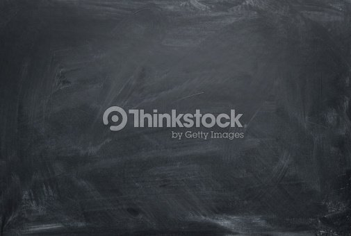 a dusty blank chalkboard with powder residue stock photo