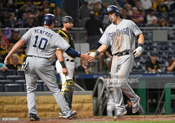 Dusty Coleman of the San Diego Padres is met at home plate by Hunter Renfroe after hitting a two run home run in the eighth inning during the game...