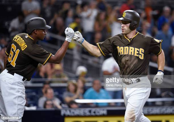 Dusty Coleman of the San Diego Padres right is congratulated by Luis Perdomo after hitting a solo home run during the fifth inning of a baseball game...
