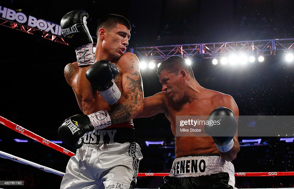 Dusty Hernadez-Harrison punches Wilfredo Acuna during their WBC Youth Welterweight Title Bout at Madison Square Garden on July 26, 2014 in New York City.