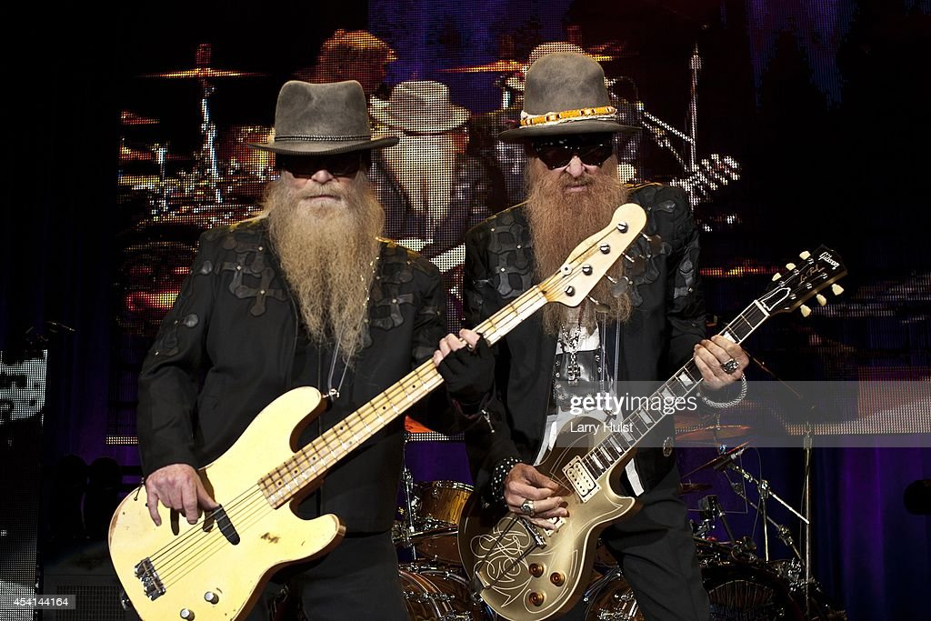 Dusty Hill and Billy Gibbons are performing with 'Z Z Top' at Fiddlers Green in Englewood Colorado on August 20 2014