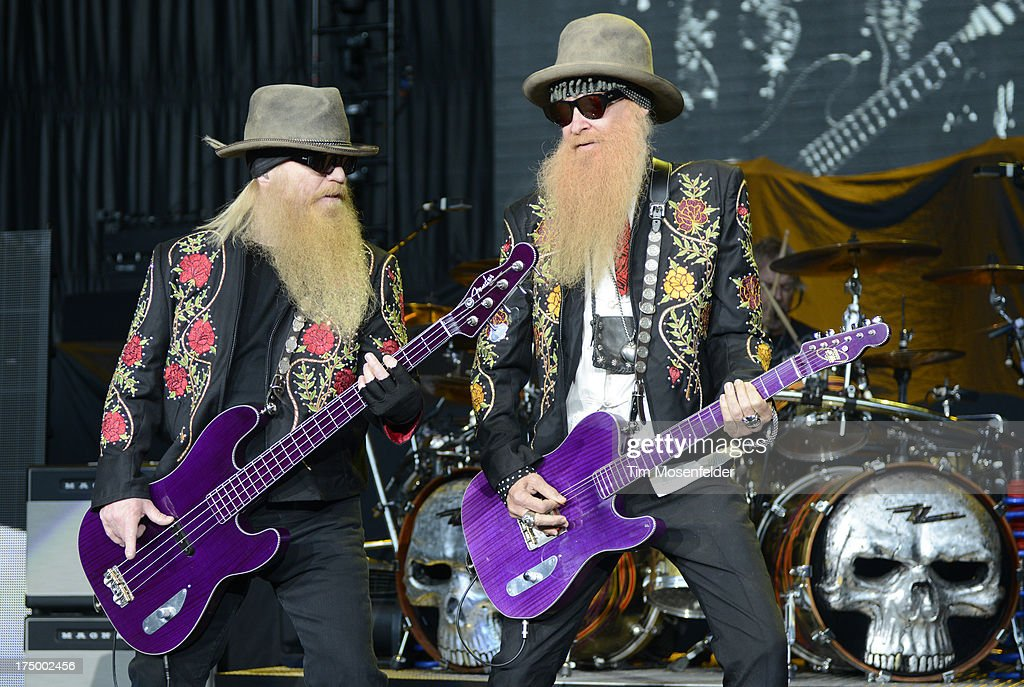 Dusty Hill (L) and Billy Gibbons of ZZ Top perform at Shoreline Amphitheatre on July 28, 2013 in Mountain View, California.