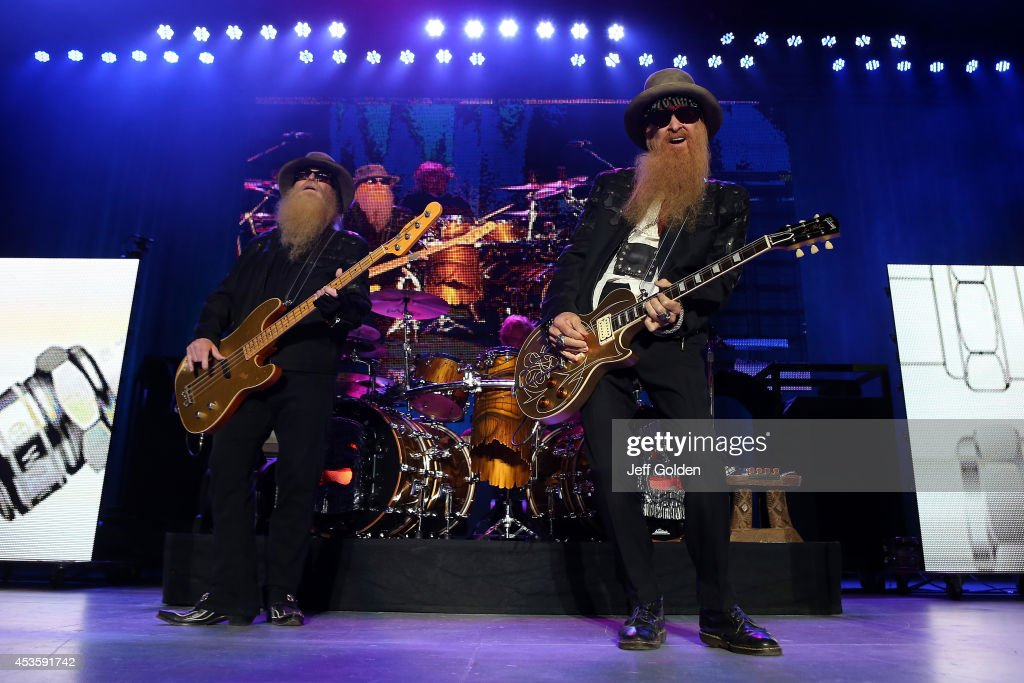 Dusty Hill, Frank Beard and Billy Gibbons of ZZ Top perform at The Greek Theatre on August 13, 2014 in Los Angeles, California.
