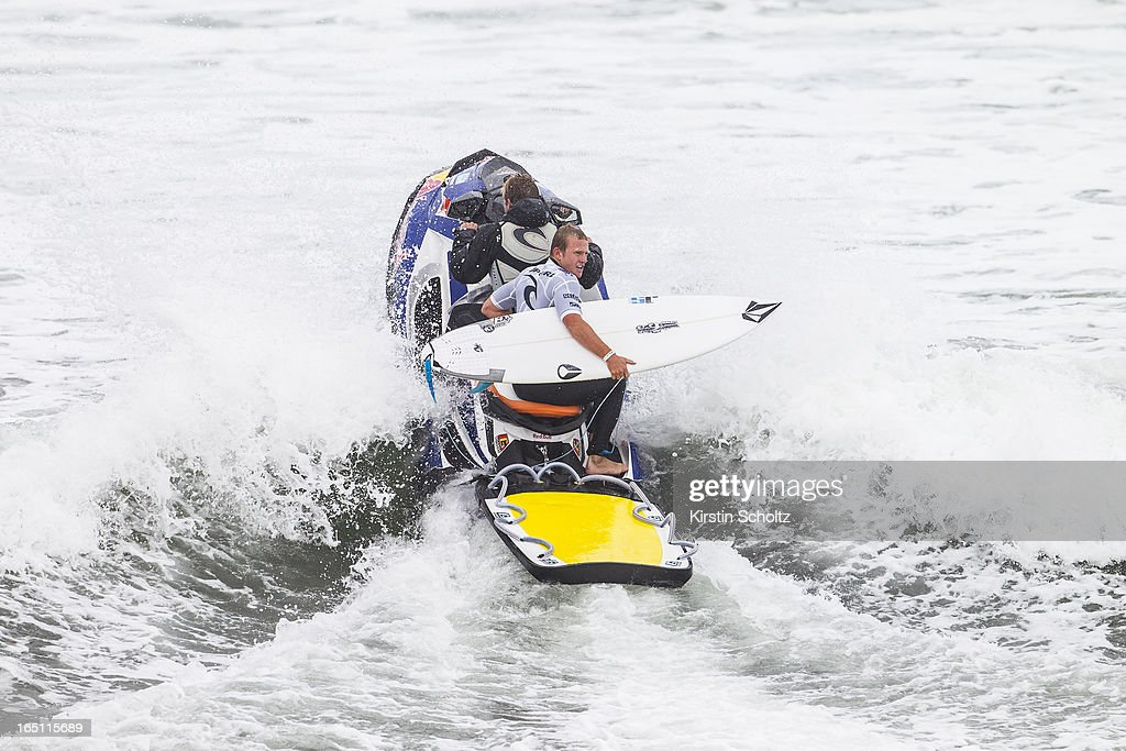 Dusty Payne of Hawaii rides the jet ski back into the lineup on March 31, 2013 in Bells Beach, Australia.