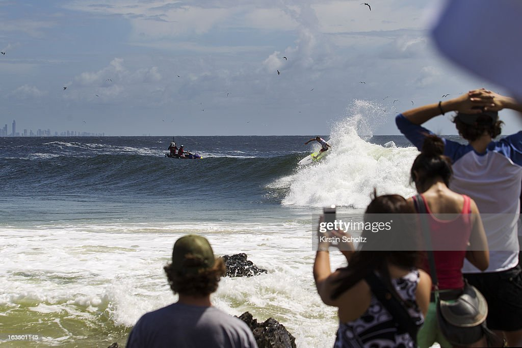 Dusty Payne of Hawaii surfs as the crowd watch during the Quiksilver Pro on March 11, 2013 in Gold Coast, Australia.