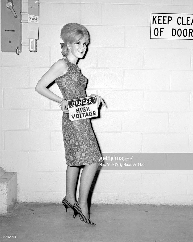 Dusty Springfield, famous female recording star, arrives at Kennedy Airport.
