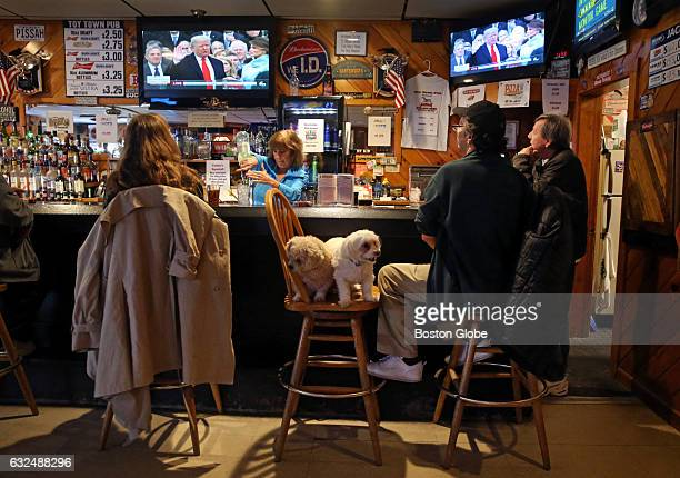 DustyScott Dunton second from right of Fitzwilliam NH is accompanied by his dogs Sissy and BuckABoo while watching President Donald Trump take the...