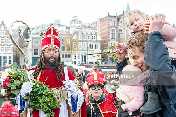 Dutch actor Patrick Mathurin dressed as Sinterklaas meets people in Amsterdam on November 5 2016 Actor Mathurin is one of the antiracism...
