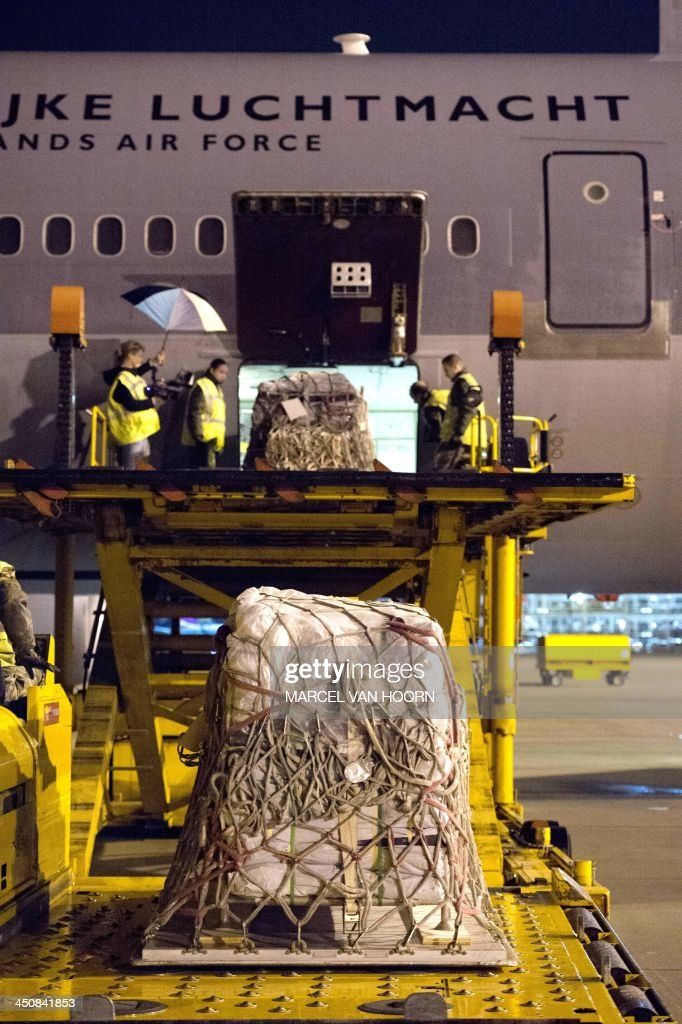 Dutch air force staff load relief supplies of Dutch Cooperating Aid Organizations into a plane for the victims of the Haiyan typhoon in the...
