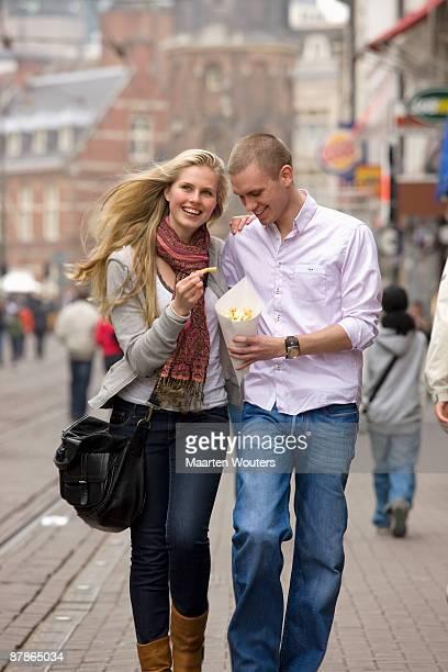 dutch amsterdam tourist couple eating fries
