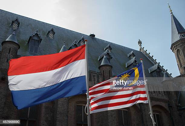 Dutch and a Malaysian flag fly prior to the arrival of Malaysian Prime Minister Najib Razak for his meeting with Dutch Prime minister Mark Rutte on...