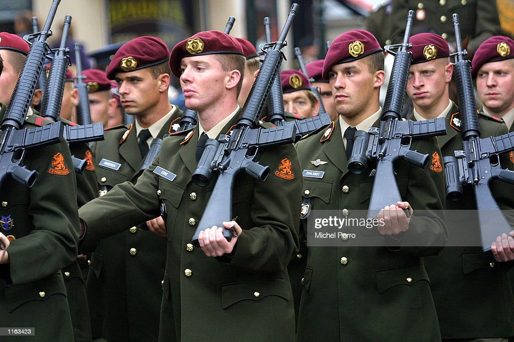 Dutch army officers march amid incresing security during the parade of Dutch Queen Beatrix on her way to present the cabinet with the budget for 2002 September 18, 2001 at the Hague. The queen earlier paused outside the US Embassy to pay respects to the victims of the recent terrorist attacks.