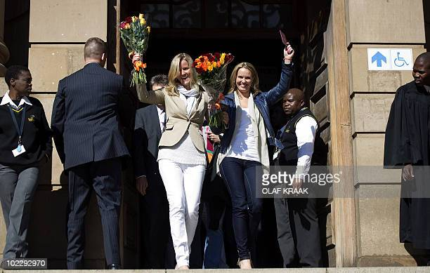 Dutch Barbara Castelein and Mirte Nieuwpoort leave the courtroom in Johannesburg on June 22 2010 Charges were dropped against the two women who were...