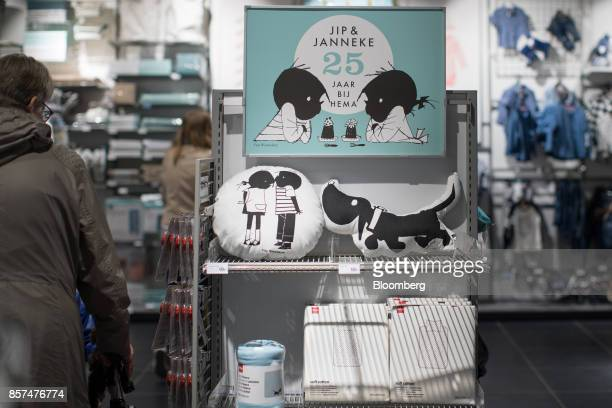Dutch cartoon characters Jip and Janneke sit on cushions as customers browse homeware inside a Hema BV store in Tilburg Netherlands on Wednesday Oct...