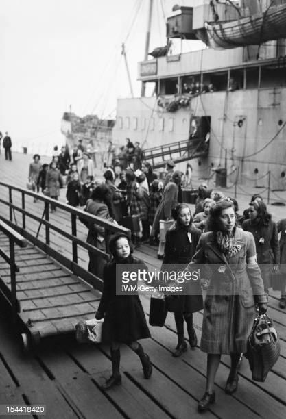Arrival In Britain At Tilbury Essex England UK A Dutch school teacher leads a group of refugee children away from the ship upon which they have just...