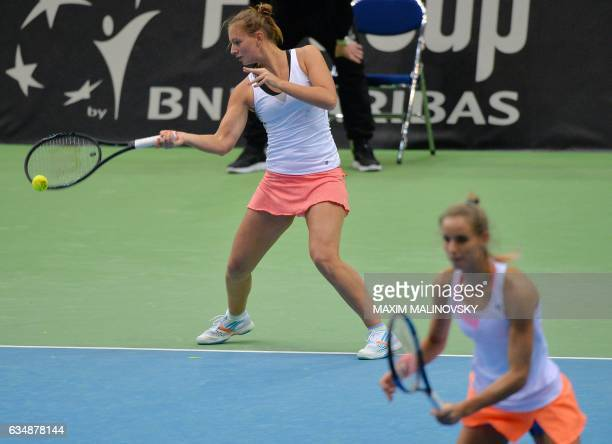 Dutch Cindy Burger and Arantxa Rus return a ball to Olga Govortsova and Vera Lapko of Belarus during the Fed Cup World Group first round doubles...