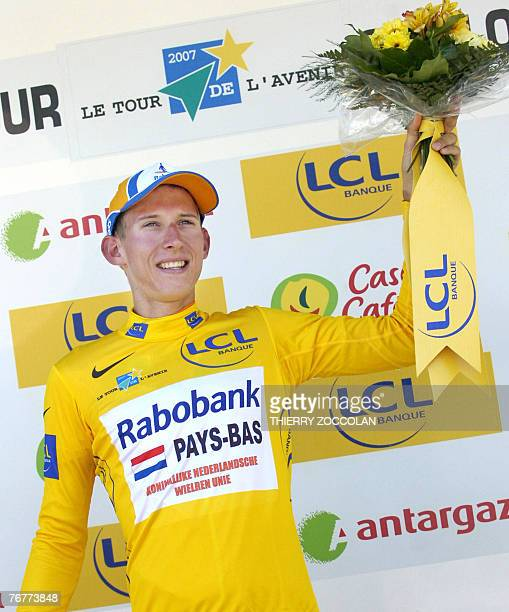 Dutch cyclist Bauke Mollema poses on the podium after winning the 44th edition of the Tour de l'Avenir cycling race in Saint Flour central France 15...
